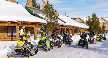 Snowmobilers outside a local snowmobiling lodge
